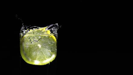 Lemon drop black background water Wallpaper