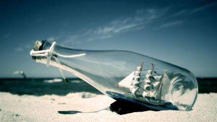 Bottles sand sea ship in bottle ships Wallpaper