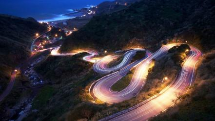 Lights long exposure mountains night roads Wallpaper