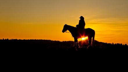 Wyoming horseback riding silhouettes sun flare sunset wallpaper