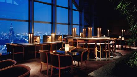 Lights tables skyscrapers chairs window panes interior designs Wallpaper