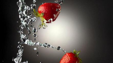 Water drops strawberries slow motion Wallpaper