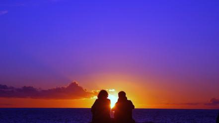 Romantic couple at sunset Wallpaper