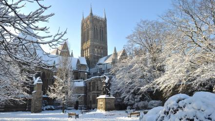 Snow trees bench church statues Wallpaper