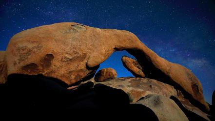 Rocks night sky arches rock formations Wallpaper