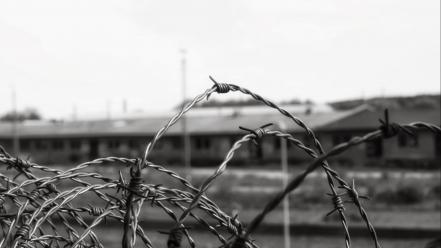 Urban exploration barbed wire grayscale trains wallpaper
