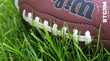 American football wilson balls brown grass Wallpaper