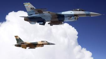 Two F16S Over Clouds Wallpaper