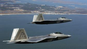 Two F22S Over Sea wallpaper