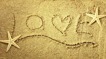 Love sand starfish writing Wallpaper