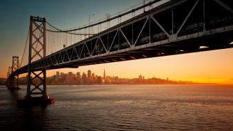 Oakland bay san francisco bridges cityscapes sunset Wallpaper
