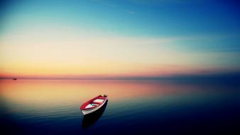 Row boats sea sunset wallpaper