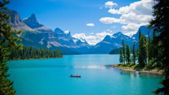 Canada maligne lake canoe clouds forests wallpaper
