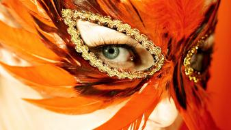 Venetian masks eyes feathers orange wallpaper