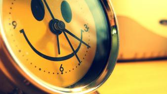 Alarm clocks happy smiley face yellow wallpaper