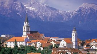 Mountains houses town church slovenia wallpaper