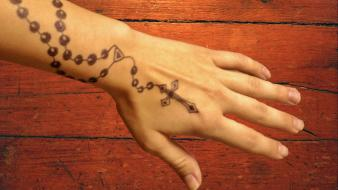 Christianity henna cross hands rosary wallpaper