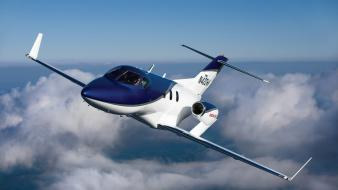 Aircraft clouds flying hondajet skyscapes wallpaper