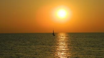 Sun boats sea sunrise wallpaper