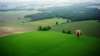 Grass green hot air balloons spring wallpaper