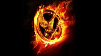 Flames birds logos the hunger games mockingjay wallpaper
