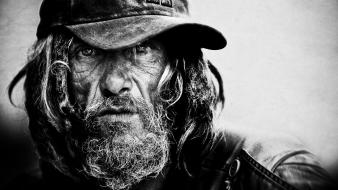 Black and white men homeless person faces portraits wallpaper