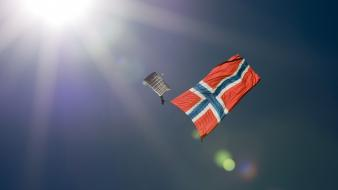 Sun parachuting blue skies flag of norway wallpaper
