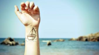Boats arms raised body painting blurred background wallpaper