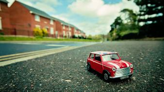 Close-up cars houses miniature roads macro effect wallpaper