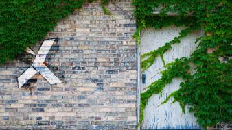 Graffiti plants brick wall painting Wallpaper