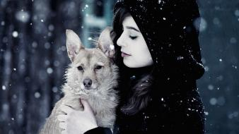 Women snow dogs wallpaper