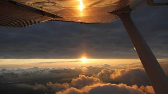 Sunset clouds cessna skyhawk wallpaper