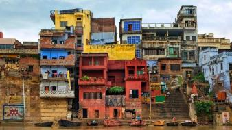 Clouds cityscapes houses asia rivers slum area india wallpaper