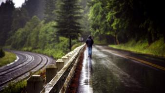 Rain fences people railroad tracks roads wallpaper