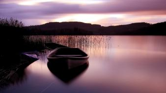 Water mountains nature boats lakes reeds Wallpaper
