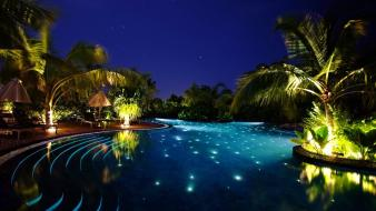Ocean night lights palm trees swimming pools wallpaper