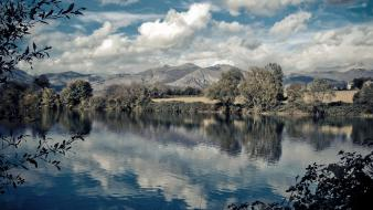 Clouds landscapes nature national geographic italy lakes reflections Wallpaper