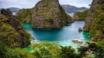 Ocean beach tropical cliffs philippines islands boats wallpaper