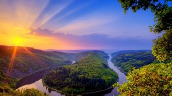 Beautiful sunset over river Wallpaper