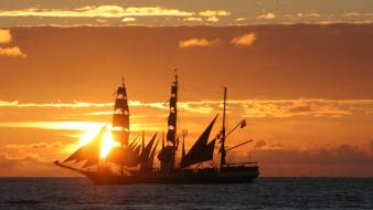 Sunset sunrise ocean ships sailing skyscapes sea wallpaper