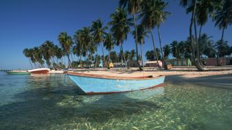 Landscapes nature beach boats palm trees sea Wallpaper