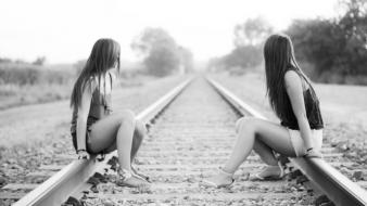 Grayscale railroad tracks girls in nature wallpaper