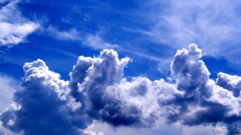 Blue clouds white fluffy skies wallpaper