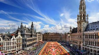 Clouds cityscapes flowers people buildings europe church belgium wallpaper