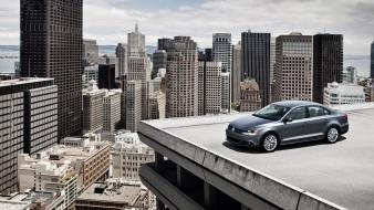 Cars skyscrapers german volkswagen jetta cities roof wallpaper