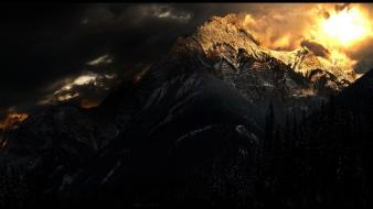 Mountains clouds dark forest skies wallpaper