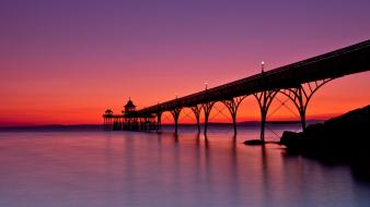 Sunset england rocks pier seascapes arches piers somerset wallpaper