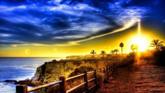 Sunrise nature coast fences buildings roads palm trees Wallpaper