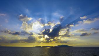 Sunset clouds graphics skies sea Wallpaper