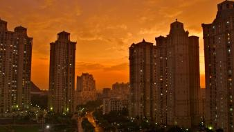 Sunset clouds tower buildings cities skies wallpaper